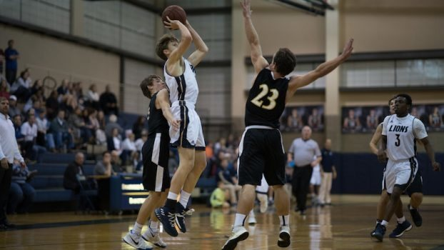 Hayden Lamey, above, Jack Dicen and Izaiah Jones all scored at least 14 points in Briarwood's 72-59 win over Westminster at Oak Mountain.